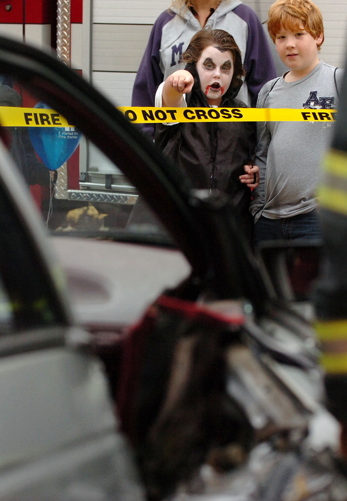 Steven Yoder, 8, (left) and Nick Hopkins, 8, both of Bangor, watch as members of the Bangor Fire Department demonstrate the use of the Jaws of Life, which are used to extricate victims of motor vehicle accidents, at the department's Fire Prevention Month Open House on Saturday, Oct. 31, 2009. (Bangor Daily News/Bridget Brown)