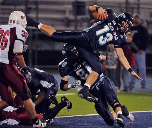 Maine quarterback Warren Smith, (13), dives into the endzone for a touchdown in the second half of their NCAA football game against Massachusetts in Orono, Maine, Saturday, Oct. 31, 2009. (AP Photo/Michael C. York)