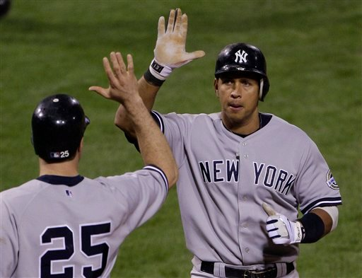 New York Yankees' Alex Rodriguez is congratulated by Mark Teixeira (25) after hitting a two run during the fourth inning of Game 3 of the Major League Baseball World Series Saturday, Oct. 31, 2009, in Philadelphia. The hit, originally called a double, was reversed to a home run. (AP Photo/Julie Jacobson)