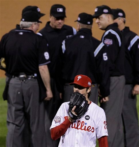 Philadelphia Phillies' Cole Hamels waits while umpires discuss a hit by New York Yankees' Alex Rodriguez to right field during the fourth inning of Game 3 of the Major League Baseball World Series Saturday, Oct. 31, 2009, in Philadelphia. The hit, originally called a double, was reversed to a two run home run. (AP Photo/Julie Jacobson)