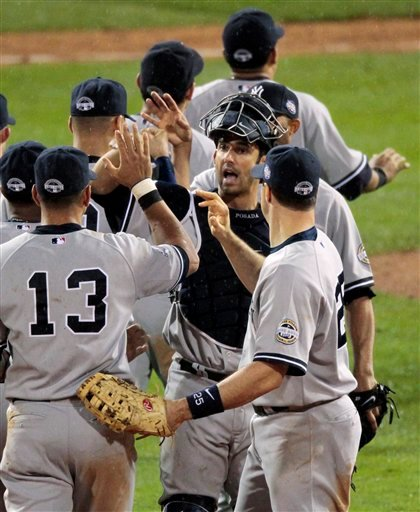 The New York Yankees celebrate after beating the Philadelphia Phillies 8-5 in Game 3 of the Major League Baseball World Series Sunday, Nov. 1, 2009, in Philadelphia. The Yankees take a 2-1 lead in the best-of-seven series. (AP Photo/Eric Gay)