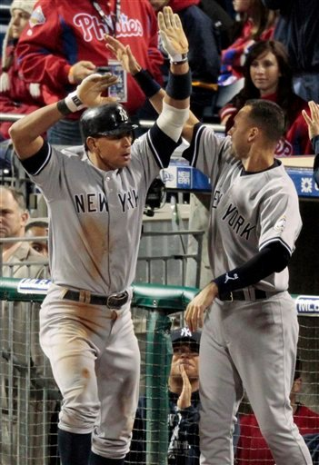 New York Yankees' Alex Rodriguez celebrates with Derek Jeter after scoring in the ninth inning of Game 4 of the Major League Baseball World Series against the Philadelphia Phillies Sunday, Nov. 1, 2009, in Philadelphia. Rodriguez drove in the go-ahead run in the Yankees' 7-4 win. (AP Photo/Eric Gay)