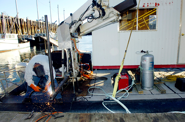 A welder welds a piece for a high-tech sonar system on the Medric II in Eastport on Monday, Nov. 2, 2009 at the U.S. Coast Guard station in Eastport for an underwater survey which will begin today in a joint effort between state and federal agencies for two urchin fishing vessels that recently sank in Cobscook Bay. The search will employ a high-tech sonar system which NOAA officials say has better imagery than most, can scan 50 meters at a time in either direction and aids in search and recovery efforts. BANGOR DAILY NEWS PHOTO BY BRIDGET BROWN
