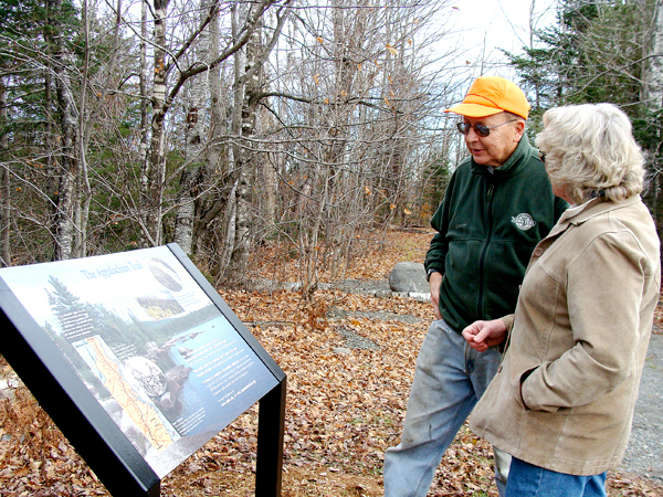 Ken Beach, a year round Whetstone Pond resident in Abbot, attended the  dedication and unveiling of the new trail head sign Monday at the  Appalachian Trail head off Route 15 in Monson. Donna Moreland Fichtner,  a member of the Piscataquis County Nature Tourism Subcommittee that had  the sign erected, talks with Beach, who hiked the Appalachian Trail in  2003.    BANGOR DAILY NEWS PHOTO BY DIANA BOWLEY