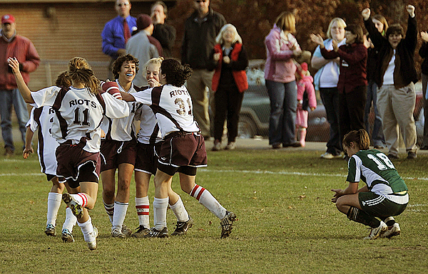 While Fort Kent's Katelyn Roy,(18), waits for the game to restart Orono Riots teammates of Ruth Mares ,(12), celebrate her goal in the second half in Orono, Maine, Tuesday, Nov. 3, 2009. Bangor Daily News/Michael C. York