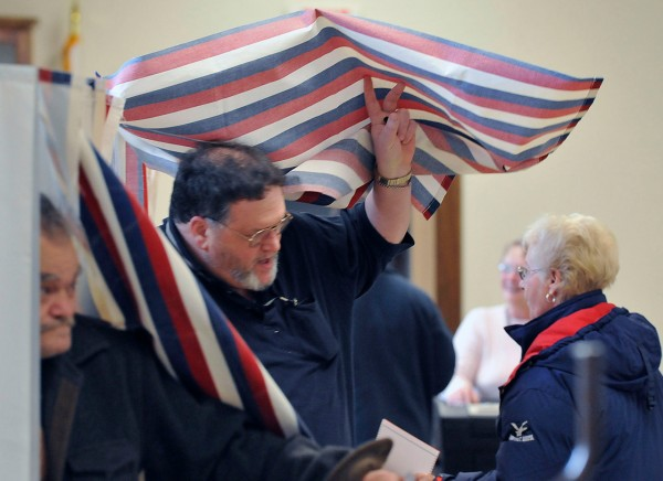 Voter turnout was steady in Old Town on Tuesday morning. Steve Martell leaves the booth after voting in Old Town's Ward 2. Buy Photo