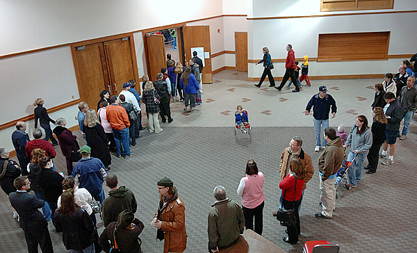 Bangor voters wait in line to vote at the Bangor Auditorium on Tuesday. Election officials in Bangor were expecting to exceed 50 percent voter turnout despite it being an off-year election. Buy Photo