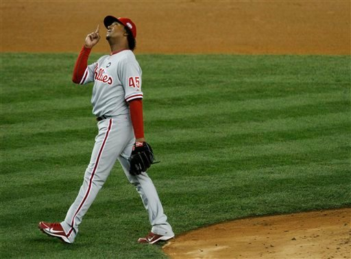Philadelphia Phillies' Pedro Martinez points up as he is taken out of the game during the seventh inning of Game 2 of the Major League Baseball World Series against the New York Yankees Thursday, Oct. 29, 2009, in New York. (AP Photo/Julie Jacobson)