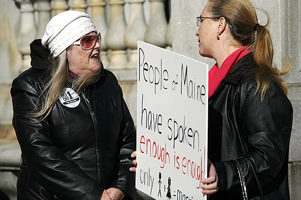 Two people argue their differences regarding same-sex marriage in front of City Hall,  in Portland, Maine, on Wednesday, Nov. 4, 2009, a day after voters rejected the gay marriage law. (AP Photo/Pat Wellenbach)