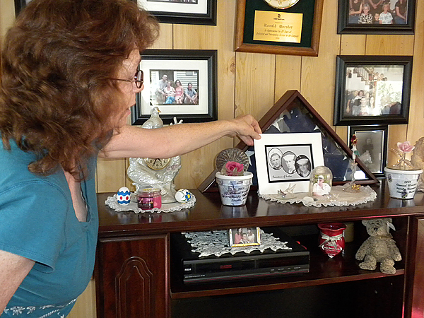 Lincoln resident Pat Worster adjusts a photo of her brother Clyde Worster at her home in this August 2009 photograph. Clyde Worster was killed in April 2008 by Stephen James who has admitted to killing Worster and will be sentenced this week. (Bangor Daily News/Nok-Noi Ricker)