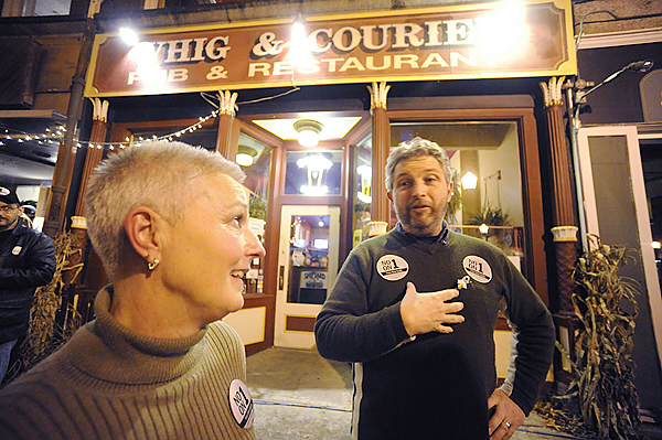 (BANGOR DAILY NEWS PHOTO BY JOHN CLARKE RUSS)  CAPTION  Bridge Alliance president Jeanne Paradis,left, and vice president Greg Music discuss the election results during the alliance's &quotNo On One Vote&quot Watch Party Tuesday night's at the Whig & Courier in downtown Bangor. The Bridge Alliance connects the gay,lesbian, bisexual, transgender and ally community in the greater Bangor area. (Bangor Daily News/John Clarke Russ)