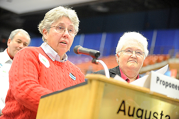 (BANGOR DAILY NEWS PHOTO BY JOHN CLARKE RUSS)  CAPTION  With her partner Kay Wilkins at her side, Diana Cate (cq),left, speaks in support of same-sex marriage during the Judiciary Committee's public hearing April 22, 2009 at the Augusta Civic Center. Tuesday's referendum vote repealed the the new law to allow same-sex marriages. (BANGOR DAILY NEWS PHOTO BY JOHN CLARKE RUSS)