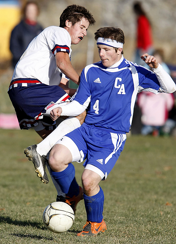 PHOTO: JASON P. SMITH..... Bangor Christian's Matt Swanson collides with Central Aroostook's Zach Amnott during the Eastern Maine Class D finals game in Bangor on Wednesday, November 4, 2009.