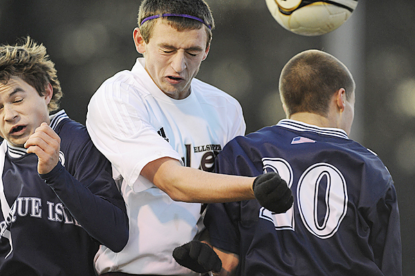 Ellsworth High School's Zach Emeigh (center) gets squeezed by Presque Isle High School's Wilder York (left) and Nate Ackerson (right) as they go up to head a ball in the first half of their eastern Maine Class B boys soccer final in Ellsworth Wednesday afternoon, November 4, 2009. Ellsworth won 2-1. (Bangor Daily News/John Clarke Russ)