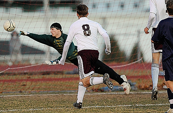 Presque Isle goal keeper Dillon Kingsbury deflects as Ellsworth's Jakob Jordan ( #8) and others close in during the first half of their eastern Maine Class B boys soccer final in Ellsworth Wednesday afternoon, November 4, 2009. Ellsworth won 2-1. (Bangor Daily News/John Clarke Russ)