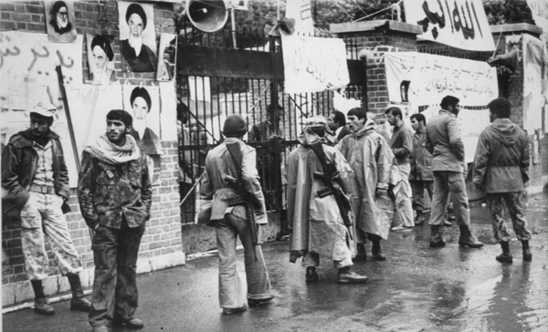 MILITANTS ON PARADE -- Rifle-bearing Iranian students parade in front of the American Embassy in Tehran, three days after occupying the embassy and taking its personnel hostage. The militants were demanding the return of the Shah of Iran. (AP Laserphoto) Feb. 8, 1980