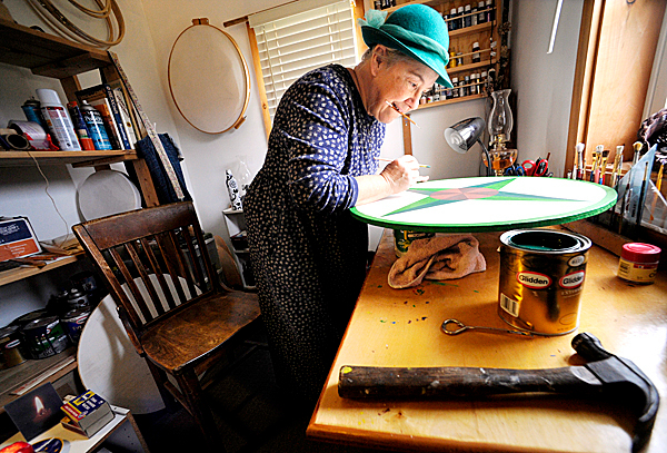 J.J. Starwalker works on one of her Dutch hex signs in her home studio in West Corinth October 29, 2009. In keeping with hex sign making tradition, she wears a hat to &quotcover thy head in the presence of the divinity, &quot she said. BANGOR DAILY NEWS PHOTO BY JOHN CLARKE RUSS