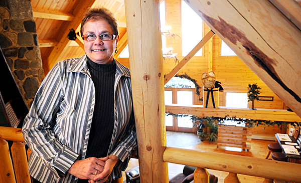 Lucy Comber (pictured) and her husband Randy Comber are the owners of Mooshead Cedar Log Homes Greenville.  BANGOR DAILY NEWS PHOTO BY GABOR DEGRE