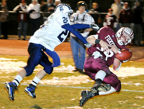 Foxcroft Academy's Ian Champeon (right) can't hang onto the ball in the endzone after he was hit by Stearns High School's Josh MacDonald during the second quarter of the game in Dover-Foxcroft Friday evening.