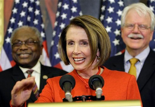 Speaker Nancy Pelosi, center, is joined by (L-R) Majority Whip James Clyburn, and Rep. George Miller, D-Calif. during a press conference at the U.S. Capitol, Saturday, Nov. 7, 2009 in Washington after the passage in the house of the health care reform bill. (AP Photo/Alex Brandon)