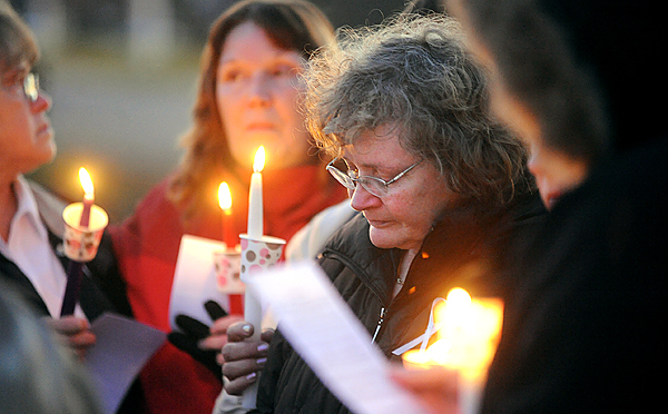Surrounded by her family and friends, Sandra Goodrich quietly wiped away her tears during Sunday evening's candlelight vigil on Sebasticook Lake in Newport .  Seventeen people sang and prayed as they stood in a circle. The vigil was held in the memory of Sandra's husband, Perely Goodrich Sr., who was alledgedly killed by their son Perely Goodrich Jr. in late October.  &quotHe [Perley Sr.] was always joking and he was such a wonderful person.&quot said Sandra's friend Margaret Kennedy.  People who would like to help can donate to the Sandra Goodrich fund at Bank of America.(Bangor Daily Nws/Gabor Degre)