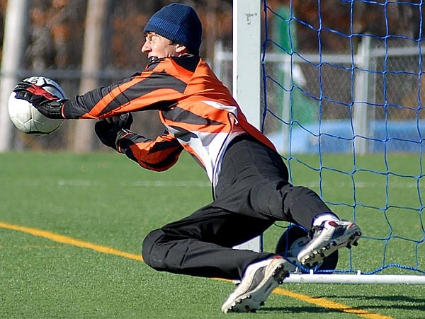 HAMPDEN, ME -- NOVEMBER 6, 2009 --Bangor Christian goalie Tyler Alexander blocks a penalty shot in the second half of the boys Class D state championship game on Saturday.  Bangor Christian defeated Richmond 2-1.  LINDA COAN O'KRESIK