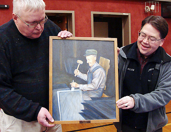 William ''Bill'' Sawtelle of Brownville, left, and Allen Monroe of Milo,  hold a portrait of Sawtelle's late grandfather Will Roberts, a slate  splitter of Brownville, that Sawtelle donated last week to the  Brownville Elementary School.  Monroe painted the oil portrait. (Bangor  Daily News Photo by Diana Bowley)