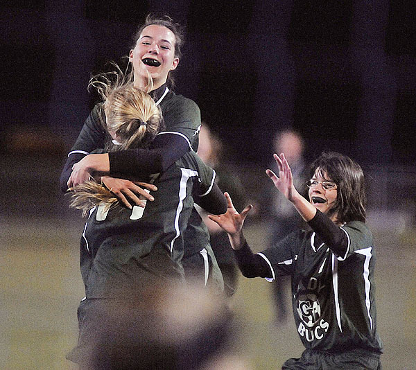 Georges Valley's Jessica Veilleux is held aloft by teammate Jennifer Denault, (11), and with Holly Ames-Allen, (7), they celebrate Veilleux's first half winning goal versus Orono, in Hampden, Saturday, Nov. 7, 2009. Bangor Daily NEws/Michael C. York