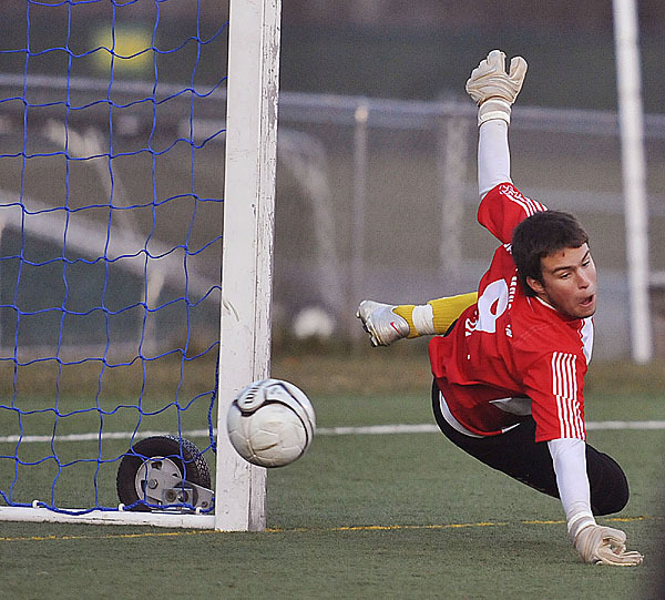 Fort Kent keeper Alex Charette dives in an attempt to make a save in the second half of their game versus St Dom's , Saturday, Nov. 7, 2009. Bangor Daily NEws/Michael C. York