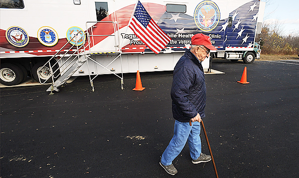 (BANGOR DAILY NEWS PHOTO BY GABOR DEGRE)  CAPTON  Korean War veteran Clayton Lancaster, 78 of Dexter walks back to his car after visiting the Togus Mobile Healthcare Clinic for some lab work in Dover-Foxcroft Wednesday.  The unit is one of four in the country and it will rotate between the towns of Greenville, Jackman, Bingham and Dover-Foxcrof on a monthly schedule.  &quotThis saves me the trips to Bangor.  I think veterans miss an opportunity if they don't use it.[Mobile Clinic]&quot Lancaster said. (Bangor Daily News/Gabor Degre)
