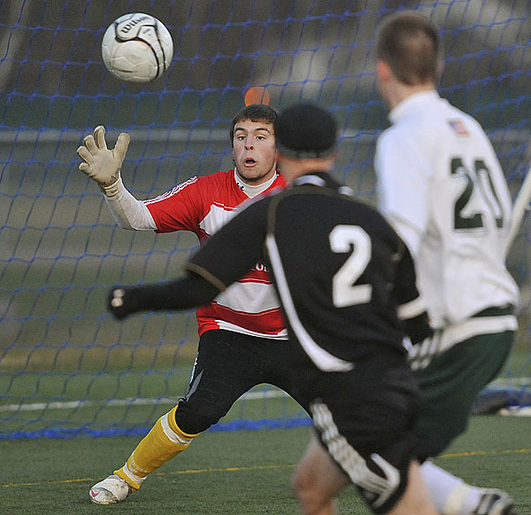 Fort Kent's keeper Alex Charette stops a shot by St Dom's Alex Parker, (2), in the second half of their game in Hampden, Saturday, Nov. 7, 2009. Bangor Daily NEws/Michael C. York