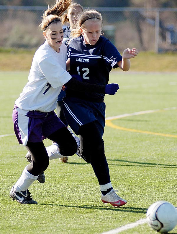 HAMPDEN, ME -- NOVEMBER 6, 2009 -- Evangeline Goodall, Southern Aroostook, and Miranda Drinkwater, Greenville, battle for the ball in the class D state championship game in Hampden on Saturday.  Southern Aroostook won 2-0. LINDA COAN O'KRESIK