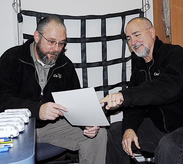 The Caribou Vet Center's mobile counseling clinic rolled into Fort Kent this week offering benefits information and mental health counseling services to area veterans and their dependents. Outreach technician Don Dare (right) confers with readjustment counselor John Theriault for a few moments before the doors were officially open. The two said the rolling clinic will make multiple appearances throughout northern Maine. (BANGOR DAILY NEWS photo by Julia Bayly)