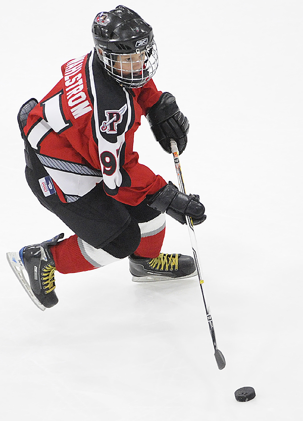 A skillful nine-year-old Oliver Wahlstrom of Cumberland shows off his hockey prowess during the first period intermission of Sunday afternoon's University of Maine-Boston University match-up at Alfond Arena in Orono.His appearance followed his new-found fame following his amazing hockey shoot-out trick on a goalie in October. (Bangor Daily News/John Clarke Russ)