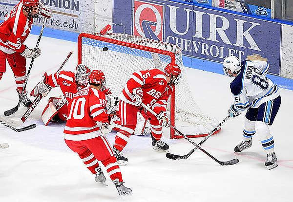 University of Maine's Gustav Nyquist (#89, right) fputs the pack past Boston University's David Warsofksy (#5), Corey Trivino (#10) and goalie Kieran Millan as he scores U Maine's second goal in the first period of their hockey match in Orono Sunday aftrnoon, November 8,2009. (Bangor Daily News/John Clarke Russ)