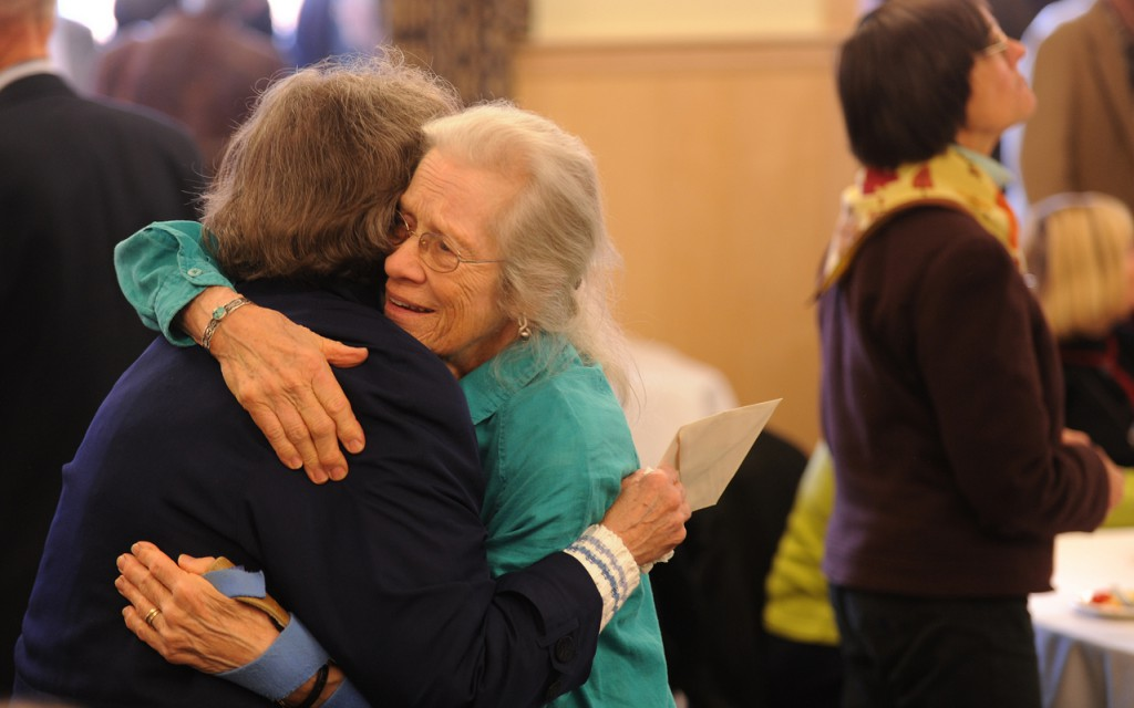 Bobby Ives, right, wife of Sandy Ives gets a hug from her neighbor, Ruby Gourley, left, on Saturday, Nov. 7, 2009 at the University of Maine during a memorial celebration in remembrabce of the late professor who served as a UMaine faculty member for 44 years. Ives founded Maine Folklife Center in 1971 and passed away in August of 2009 at the age of 83. (Bangor Daily News/Kevin Bennett)