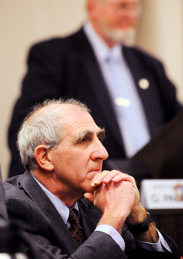 Richard Stone (foreground) was voted by the Bangor City Council as the new chairman of the council.  Stone is replacing Gerry Palmer (background) after he served a year in the position. BANGOR DAILY NEWS PHOTO BY GABOR DEGRE