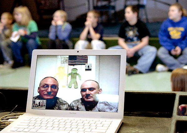 School children at the Marion C. Cook School in Lagrange talk to Master Chief Dennis Wellman (left on screen) and Tech Sgt. Joe Baker (right), both currently serving in Iraq, via Skype during a special Veterans Day ceremony Monday, Nov. 9, 2009 where Baker's son Jake, 8, and Wellman's grandson Demytrius Smith, 6, attend. The two serve in the same 101st Civil Engineering Squadron of the Maine Air National Guard out of Bangor. BANGOR DAILY NEWS PHOTO BY BRIDGET BROWN