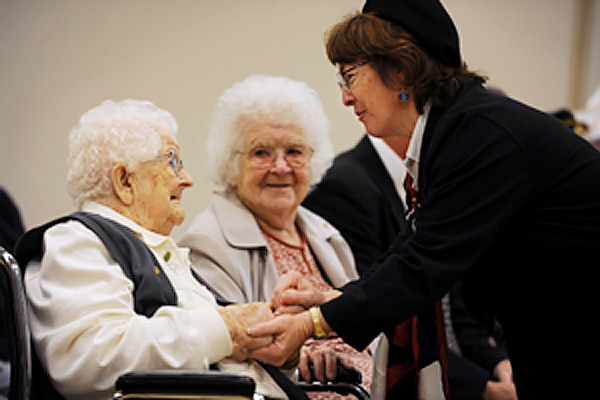 Major Eva M. Price, left, was honored for her years of service as an amry nurse on Tuesday, November 10, 2009 by VFW Womens Commander Mrs. Janet (Alfred) Michaud, right, as her sister Leila Pearson, center, watches during the ceremony at University Hall on the campus of University College of Bangor. Eighteen speakers, including Governor Baldacci, praised her for her years of service and dedication to the armed services. Price turned 100 on Jan 21, 2009. (Bangor Daily News/Kevin Bennett)