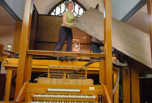 Laura Jumper of the David E. Wallace And Company out of Gorham, helps disassemble a 103-year-old Estey pipe organ at St. Mary's Church in Orono on Monday, Nov. 9, 2009. Former parishioners, Knights of Columbus members and the David E. Wallace And Company, are working this week to move the organ from the now closed St. Mary's Church to the Holy Family Church in Old Town. &quotIt's a gem well worth keeping,&quot said David Wallace of the organ. (Bangor Daily News/Bridget Brown)