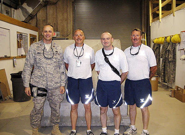 Four Piscataquis County men deployed to the Middle East were united on a Sunday morning in September at an undisclosed location in Iraq.  Major Robert Kinney, originally from Atkinson and now assigned to the 102nd  Intelligence Wing, Otis ANGB, Massachusetts was aware Penquis area friends from the 101st Air Refueling Wing Civil Engineers of Bangor were nearby while traveling in Iraq as part of his duties in the Middle East. Major Kinney and Technical Sergeant Scott Coy, who  are friends from high school and church, coordinated the meeting between old friends.  Pictured from left to right:  Major Robert Kinney (Atkinson) in the USAF Airman's Battle Uniform (ABU), Technical Sergeant Scott Coy (Dover-Foxcroft), Technical Sergeant Joseph Baker (LaGrange) and Master Sergeant Douglas Robinson (Orneville) all pictured in Air Force  Physical Training Attire an official uniform of the USAF.