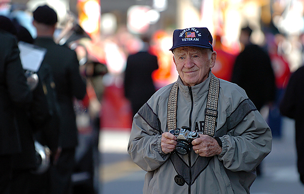 WWII veteran Dick Goodie of Westbrook waits for an opportune moment to capture for a book he is writing during the Veterans Day parade in Bangor on Wednesday, Nov. 11, 2009. (Bangor Daily News/Bridget Brown)
