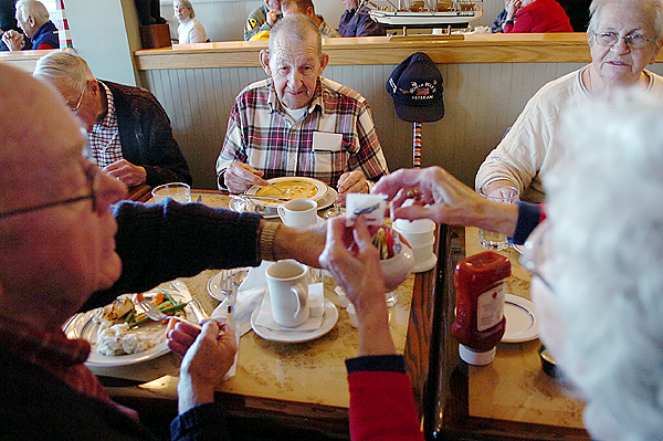 Veterans and active military personnel enjoy a free meal at the Muddy Rudder in Brewer on Veterans Day Wednesday, Nov. 11, 2009. Here veterans from WWII and the Korean War share lunch. Pictured (clockwise from left) are Keith Gove, Keith Dow, both of Hampden and Frank Ring, his wife Sally of Orrington, and Dow's wife Barbara. Dow and Ring served in WWII while Gove served in the Korean War. This is the first time the restaurant has offered the free meal on Veterans Day and employees said they expected to serve about 1,000 people Wednesday. (Bangor Daily News/Bridget Brown)