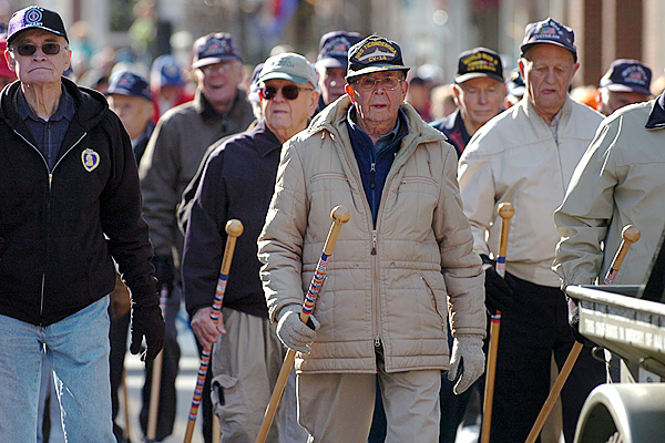 WWII veterans including Ed Hendrickson (center), a former Navy pilot, walk down Main Street in the Veterans Day parade Wednesday, Nov. 11, 2009. (Bangor Daily News/Bridget Brown)