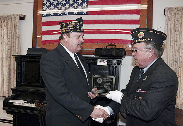 American Legion Post #30 Commander Ronald Rainfrette (at left) receives the Legionnaire of the Year Award from Post Adjutant Ray Lewis on Veterans Day. (Murray Carpenter for the Bangor Daily News)