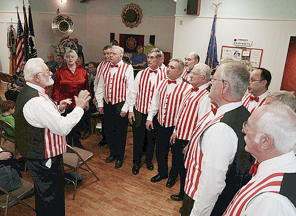 During a Veteran's Day Ceremony at American Legion Post #30 in Camden, Granville Ames,left, leads the Camden Windjammer Barbershop Chorus singing  Danny Boy. (Murray Carpenter for the Bangor Daily News)