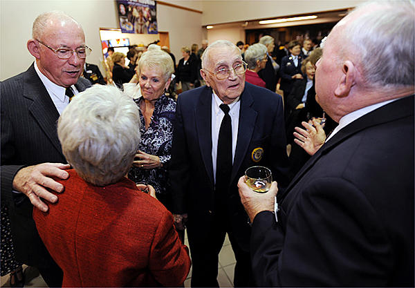 Troop Greeter, Chuck Knowlen, left, along with his wife Beverly, third from left, talks with fellow greeter, Cathy Czarnecki, (back to camera, wearing red sweater) as Bill Knight, second from right, chats with fellow greeter Ed Burns during a cocktail hour prior to being honored as the 2009 Distinguished Citizen by the Boys Scouts of America at the Bangor Civic Center in Bangor on Wednesday, Nov. 11, 2009. (Bangor Daily News/Kevin Bennett)
