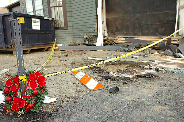 A wreath placed by Richard Sanders, 24, of Bangor rests at the corner of 40 High Street on Thursday, Nov. 12, 2009 in memory of his friend, James Blakeman, 23, who crashed a Cadillac into the building killing himself and critically injuring his passenger, Stephen Bowers. &quotHe was an all around good kid who made a bad decision yesterday,&quot said Sanders of his friend Blakeman. (Bangor Daily News/Bridget Brown)