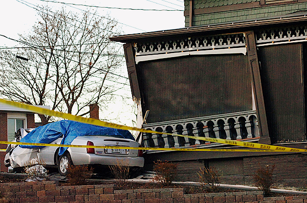 A Cadillac rests against 40 High Street on Wednesday, Nov. 11, 2009 where James Blakeman, 23, fatally crashed the car and critically injured his passenger, Stephen Bowers. (Bangor Daily News/Bridget Brown)