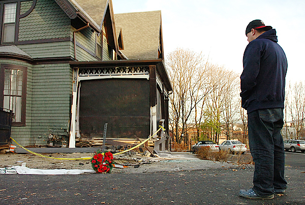 Richard Sanders, 24, of Bangor pauses at the corner of 40 High Street on Thursday, Nov. 12, 2009 where he placed a wreath in memory of his friend, James Blakeman, 23, who crashed a Cadillac into the building killing himself and critically injuring his passenger, Stephen Bowers. &quotHe was an all around good kid who made a bad decision yesterday,&quot said Sanders of his friend Blakeman. (Bangor Daily News/Bridget Brown)